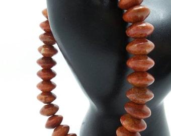 Red Jasper rondelle beaded stretch bracelet.