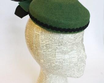 Green felt fascinator hat