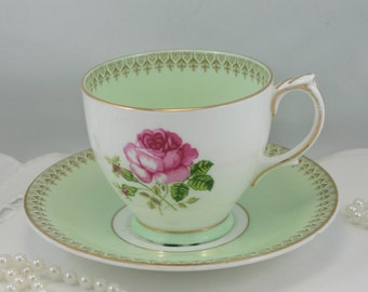 Lovely, Windsor Teacup & Saucer, Pink Rose, Pastel Green Borders, Gold Rims, Bone China made in England in 1950s.