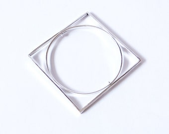 Sterling silver statement bracelet. Geometric and rotative. Circle and square.