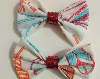 White multi colored pattern fabric hair bows