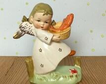 Angel Porcelain Figurine Japan Hummel Like -  AngelHolding Fish in Basket Golden Accent - Hard to Find Collectible
