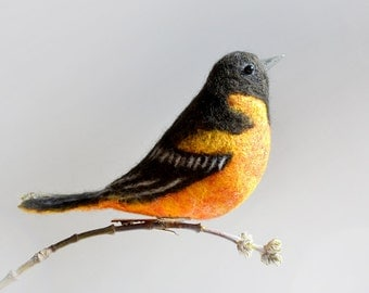 The felt bird - The Baltimore oriole is the state bird of Maryland and also the inspiration for local baseball club.