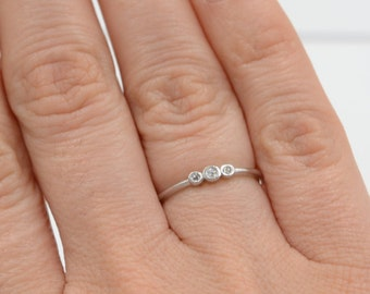 Band ring. Tiny band ring. Three cz band ring. Sterling silver band ring. Dainty cz ring. Dainty cz band ring. Trio band ring. Wedding ring.
