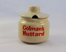 Colman's Mustard pot, likely Denby pottery seconds, from the 1970s, beige with orang writing