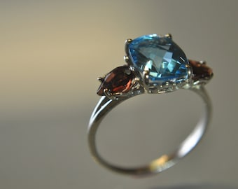 SALE PRICE 14k White gold Ring with Swiss Blue Topaz and Mozambique Garnets in a Size 8