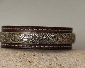 Tibetan silver Bangle on vintage leather