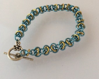 Turquoise and gold coloured chain maille bracelet