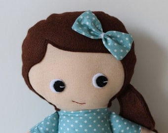 Girl rag doll with reversible, detachable skirt. Brown hair with aqua blue spotted dress.