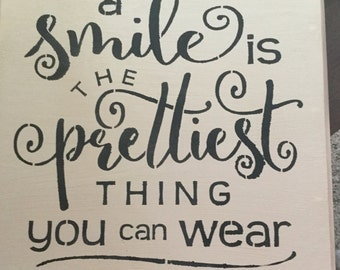 A smile is the prettiest thing you can wear....wooden sign.
