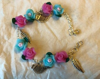 Pink and blue flowered charm bracelet