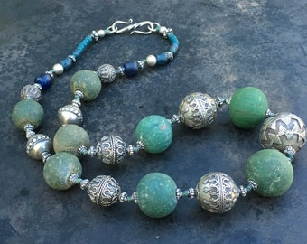 Necklace of ancient Jatim beads in soft, deep green and blue with very fine vintage beads of Bali silver