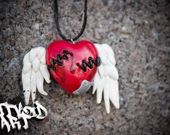 Wounded Clay Heart With Wings Necklace