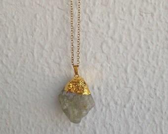 Semi-precious stone pendants in gold-plated chain.