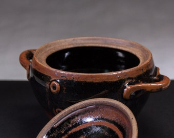Black lidded stoneware pot
