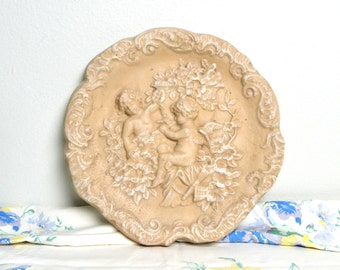 vintage cherub plaster medallion wall plaque