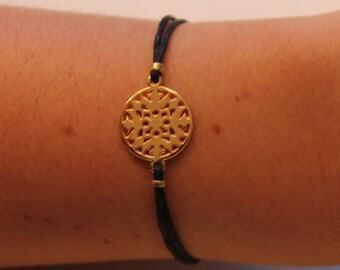 Bracelet doré et noir