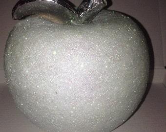 white glittered ceramic apple.