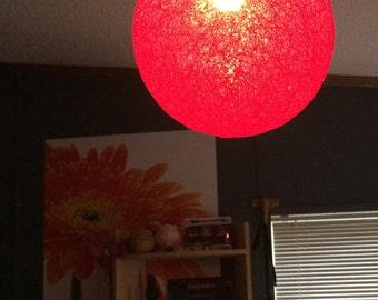 hanging red string globe lantern
