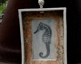 Soda fired seahorse wall hanging