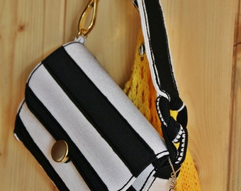 bag in black and white stripes with gold accessories