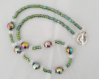 Facated ridescent green beaded necklace