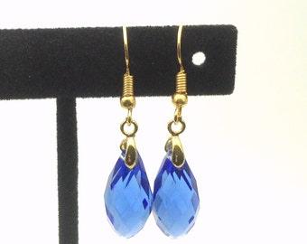 18 K yellow gold filled briolette earrings. Medium blue briolette earrings