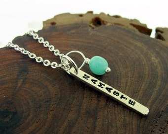 Namaste Necklace,  hand stamped silver charm with a blue bead, yoga jewelry by Kathryn Riechert