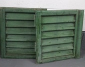 Original green painted small window shutters