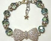 Rhinestone Bow Bracelet - Sparkly rhinestone ribbon charm with iridescent blue aurora borealis faceted glass beads and rhinestone accents