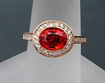 AAA Orange Sapphire   7.4x5.7mm  1.44 Carats   Oval 14K Rose gold Halo bridal set with .35cts of diamonds. 791 MMM