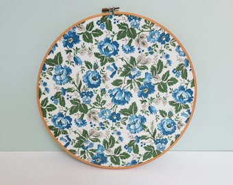 Large 1970s Floral Fabric Swatch Portrait Embroidery Hoop Art in Blue, Green and Ecru on a Cream Background