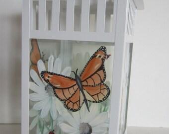 White Daisy, Monarch Butterfly, Lady Bugs on a White Metal Lantern