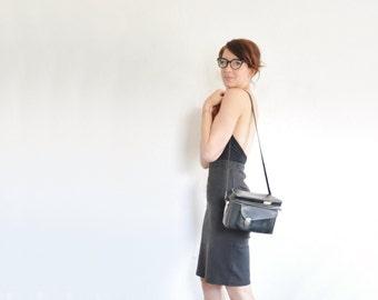 black leather camera satchel . 1970 hard boxy tote case . cross body shoulder strap