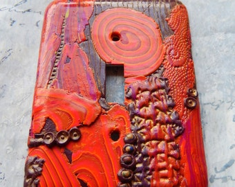 Summer on Mars, switch plate cover, polymer clay, reds, oranges, purple, burgundy, gold, whimsical, abstract