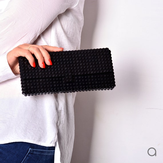 Black clutch made entirely of LEGO bricks