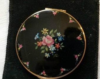 Kigu Powder Compact; Rare; Featuring a Lovely Floral Design On A Black Enamel Background circa 1940's   DR195