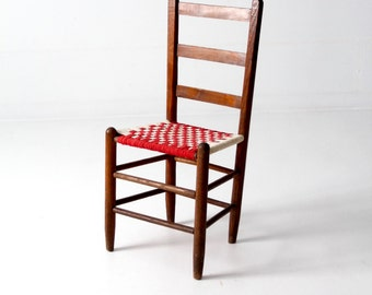 ladderback chair with woven fabric seat, antique checker accent chair
