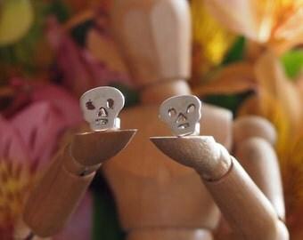 Little fine silver skull stud earrings on sterling silver posts.