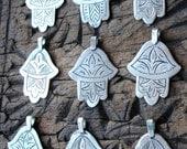 Small shiny hand engraved Moroccan hand  with three leaf fibula deisgn
