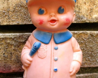 Sun Rubber Co. Police doll toy boy 1950s policeman blue soft squeeze toys dolls collectible baby teething midcentury molded unbreakable USA