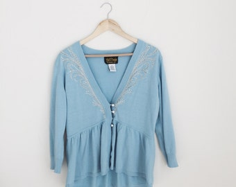 light blue peplum bob mackie sweater