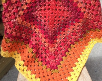 Beautiful crocheted baby blanket in sunset colours