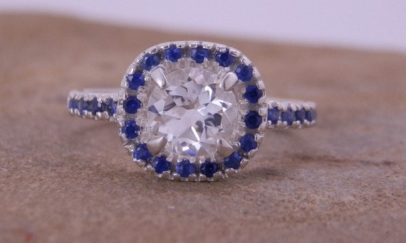 alternative engagement ring white topaz and sapphire in