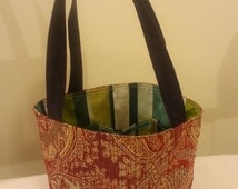 Tote bag handmade with upcycled upholstery fabric samples with six pockets, lining, magnetic closure and upcycled purple jean straps! OOAK