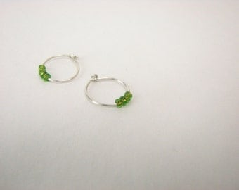 Extra Small sterling silver green beaded hoops- Tiny sterling hoop earrings, green glass beads, minimalist earrings. silver earrings beaded