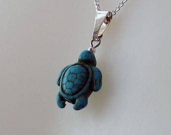 Swimmer tortoise pendant