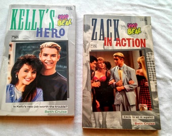 """Pair of 90's Saved By the Bell Paperbacks: """"Kelly's Hero"""" and """"Zack In Action"""" both written by Beth Cruise."""