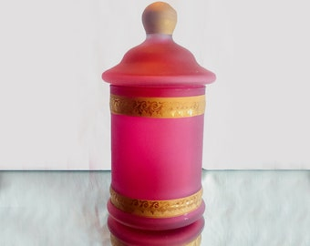 A very pretty cranberry glass jar with lid. Decorated with bands of gold gilt in an art nouveaux pattern.