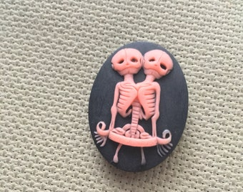 Pink on Black Conjoined Skeleton Twins Needle Minder